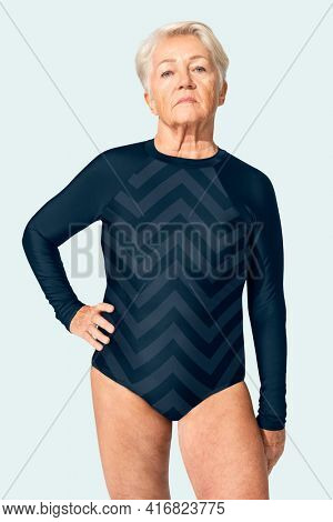 Senior woman in blue one-piece swimsuit summer apparel