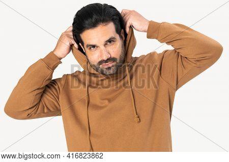 Indian man wearing basic brown hoodie close-up