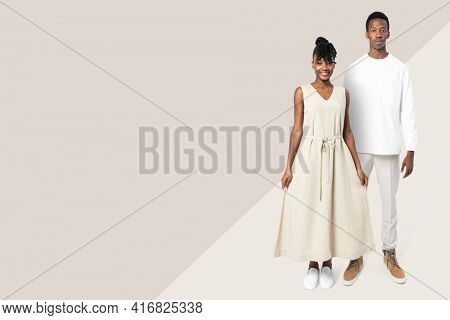 Couple in minimal outfits on beige background basic apparel