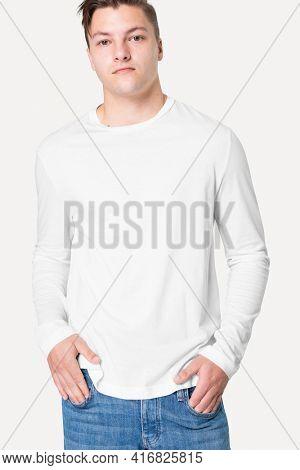 Man in white long sleeve tee men's fashion studio portrait