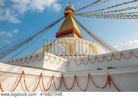 The Buddhist Prayer Flags Flowing In The Wind By Hanging On The Tiered Of Boudhanath Stupa The Large