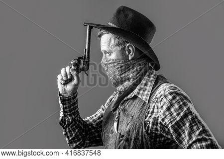West, Guns. Portrait Of A Cowboy. American Bandit In Mask, Western Man With Hat. Portrait Of Cowboy