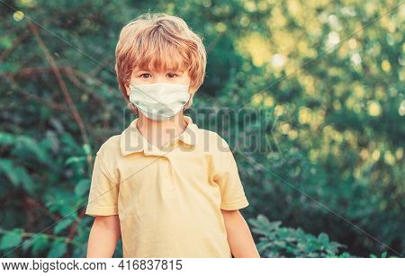 Child Wearing Face Mask During Corona Virus And Flu Outbreak. Boy In A Surgical Bandage. Boy Wearing