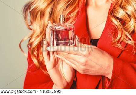 Womans With Perfum Bottle. Beautiful Girl Using Perfume. Woman With Bottle Of Perfume. Perfume Bottl