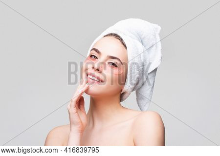 Happy Woman Applying Eye Patches. Close Up Portrait Girl With Towel On Head. Portrait Of Beauty Woma