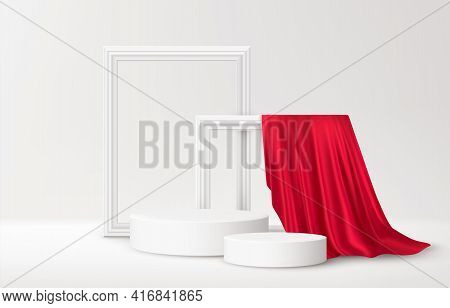 Realistic White Product Podium With White Picture Frames And Red Silk Drapery Over White Background.