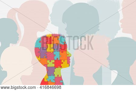 Autism Syndrome Concept. Jigsaw Puzzle That Forms The Head Of A Child S Profile With Other Children