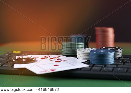 Online Gaming Platform, Casino And Gambling Business. Cards, Dice And Multi-colored Game Pieces On L