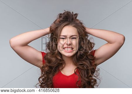 Girl Cannot Hold Negative Emotions Inside. Depressed Desperate Young Brunette Woman In Red T Shirt,
