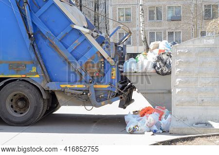 Garbage Truck Loading Garbage At The City Dump.regular Cleaning Of Street Waste.