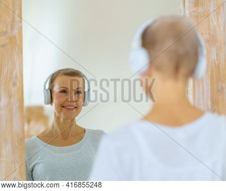 Grey Haired Senior Woman Admiring Herself In Mirror. Middle-aged Female Looks At Herself. Mature Bea
