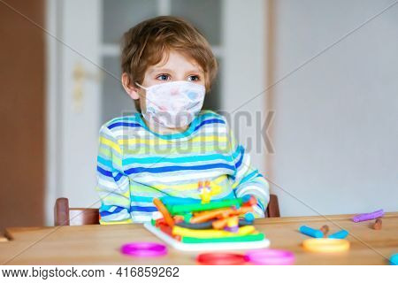 Preschool Boy With Medical Mask Having Fun With Dough, Colorful Modeling Clay. Creative Leisure With