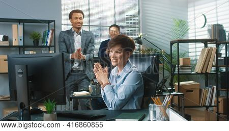 Portrait Of Cheerful Beautiful Young Caucasian Female Employee Texting On Computer Browsing Online C