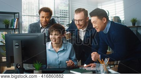 Portrait Of Beautiful Young Happy Caucasian Female Worker Typing On Computer Browsing Online Closing