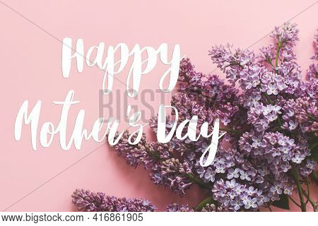 Happy Mother's Day. Happy Mother's Day Text And Lilac Flowers On Pink Paper. Stylish Floral Greeting