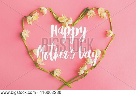 Happy Mother's Day. Happy Mother's Day Text And Floral Heart Flat Lay On Pink Paper. Stylish Floral