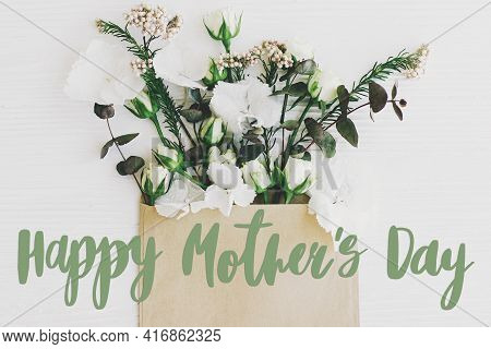 Happy Mother's Day. Happy Mother's Day Text And Lilac And Spring Flowers Blooming From Envelope On W