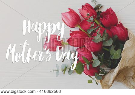 Happy Mother's Day Greeting Card. Happy Mother's Day Text And Red Tulips Bouquet In Craft Paper On R
