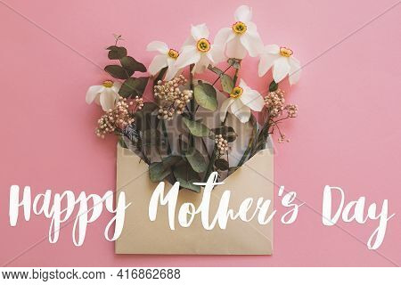 Happy Mother's Day. Happy Mother's Day Text And White Daffodils Flowers Blooming From Envelope On Pi