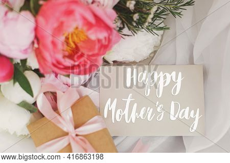 Happy Mother's Day. Happy Mother's Day Text On Card And  Beautiful Peonies Bouquet, Gift Box On Soft