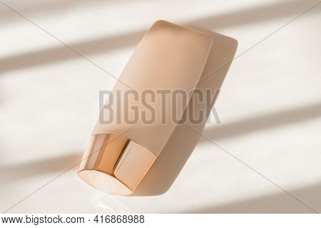 Makeup Liquid Foundation Nude Cream Cosmetic Bottle Mockup On Natural Tone Surface. Skin Care Beauty