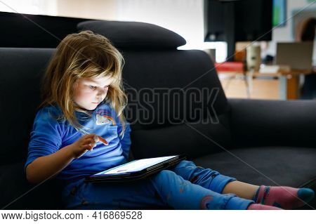 Cute Little Toddler Girl Playing With Tablet Pc At Home. Healthy Baby Touching Pad With Fingers, Loo