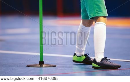 Indoor Football Player And Training Pole. Futsal Training For Children. Legs Of Young Futsal Player