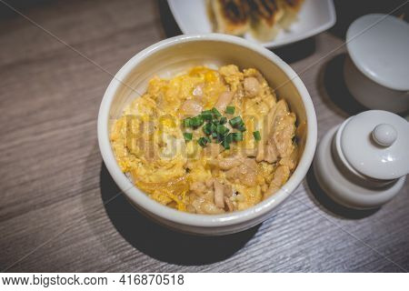 Japanes Food Gyudon Or Butadon With Egg Lunch Meal On Wood Table