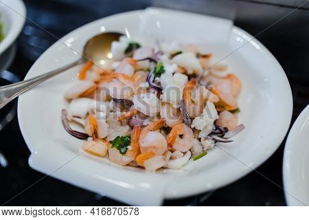 A Plate Of Fresh Steamed Seafood With Shrimps, Prawns, Crabs, Squid And Mussels