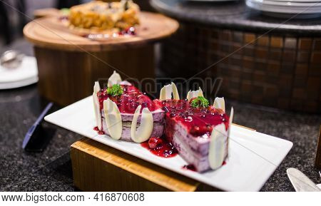 Picture Of Blueberry Layer Cake With Blueberry Jam Topping, Served On Restaurant