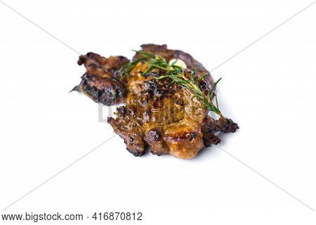 Grilled Beef Steak With Rosemary And Garlic Isolated On White Background