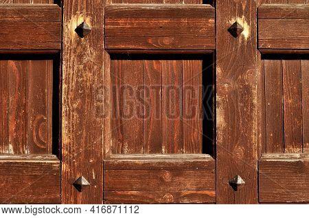 Wooden background.Vintage wooden textured door,metal rivets on the old brown wooden texture.Wooden vintage background,wooden surface,wooden pattern,wooden door,wooden background,wooden design,wooden vintage door
