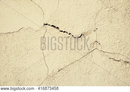 Stucco texture, stucco texture background. Old texture stucco wall with cracks and peeling stucco. Sepia vintage tones processing. Architecture texture plaster stucco background,stucco surface, stucco pattern,cracked stucco,stucco fissures