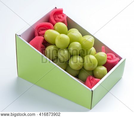 Beautiful Boxed Shine Muscat Green Grape Isolated On White Background.