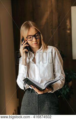 Multitasking And Workload Of An Employee, A Businesswoman Is Busy With Work, Talking On The Phone, F