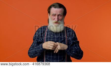 Upset Disappointed Senior Old Bearded Gray-haired Man Wipes Tears And Cries From Despair, Being Sad