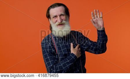 I Swear To Be Honest. Sincere Responsible Senior Old Bearded Gray-haired Man Raising Hand To Take Oa