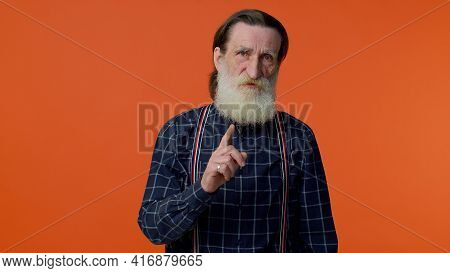 Hey You, Be Careful. Elderly Old Man In Warning With Admonishing Finger Gesture, Saying No, Be Caref