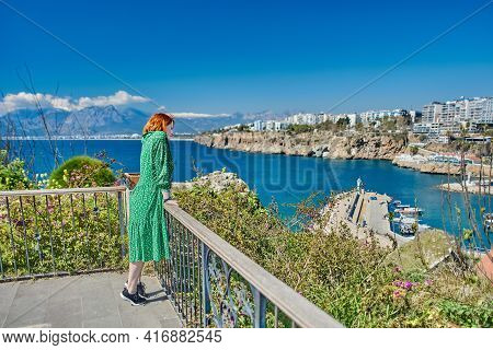 Lonely White Young Woman In Deserted Turkish Resort Of Antalya.