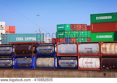 Duisburg, Germany - September 18, 2020: Shipping Containers Of Evergreen And Tank Containers In Port