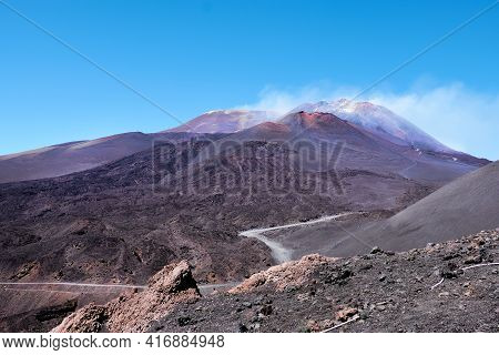 Mount Etna In Sicily Near Catania, Tallest Active Europe Volcano In Italy. Red And Purple Lava Field