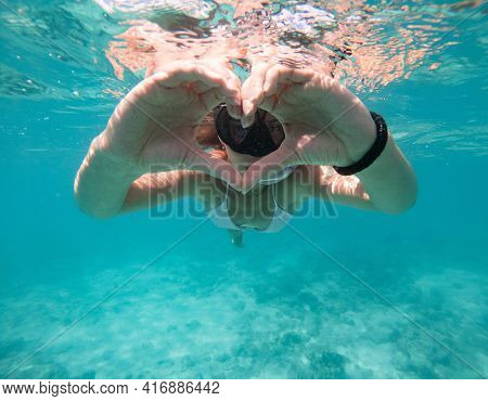 Woman Swimming Underwater. Concept Of Healthy Lifestyle And Leisure. Shot Taken With Underwater Came