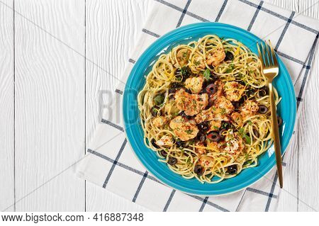 Roasted Cauliflower Pasta With Black Olives And Lemon Zest On A Blue Plate On A White Wooden Table,