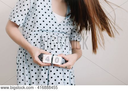 40 Weeks Of Pregnancy. Pregnant Woman Touching Belly. Happy Woman Pregnancy, Maternity, Body Care. E
