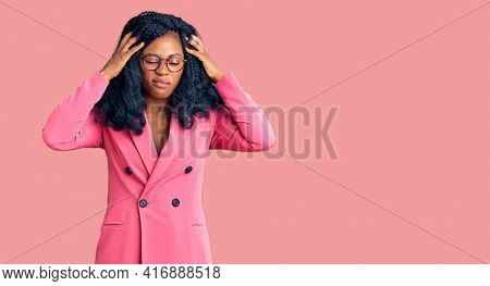 Beautiful african american woman wearing business jacket and glasses suffering from headache desperate and stressed because pain and migraine. hands on head.