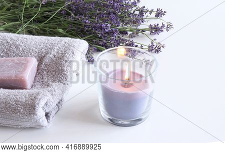 Spa Treatment And Massage Products With Towel, Aromatic Oil, Natural Soap And Lavender Flowers On A