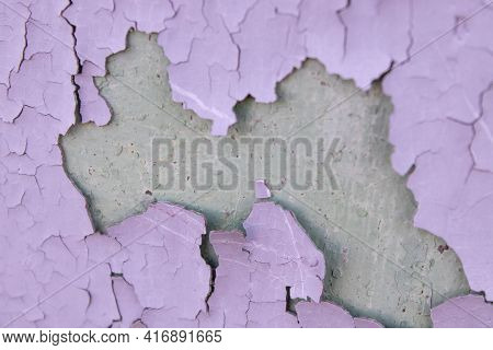 Cracked Purple Oil Paint On The Aged Metal Surface. Cool Grunge Crackle Texture. Fractured Pattern.