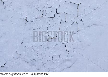 Cracked Blue Oil Paint On Aged Metal Surface. Cool Grunge Crackle Texture. Fractured Pattern. Peelin