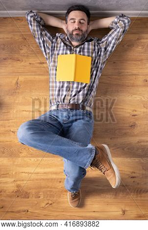 Man relaxing on floor thinking idea solitions. Man student lying studying and book or notebook. Creative inspiration study concept