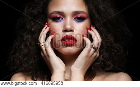 Fashion and beauty concept: attractive african american woman with bright make up closeup portrait